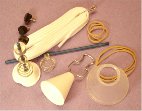 Set includes the Tugger, Retaining cone, Pusher, short and long center Rods, Collar, 2 spare set screws and fail-safe lace, plus stainless conical inner spring with washer and 6 sample rubber bands